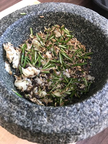 Herbs mix in the pestle and mortar